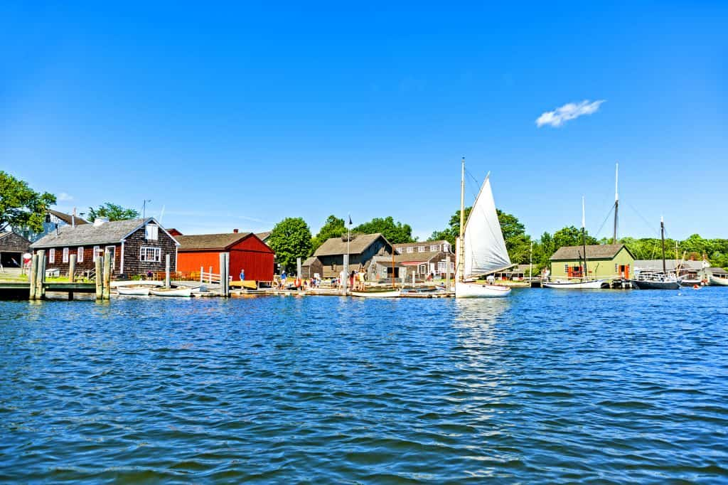 Mystic, CT, USA - July 6, 2014: People enjoy a sunny day in the Mystic Seaport. Mystic is one of Connecticut primer destinations.