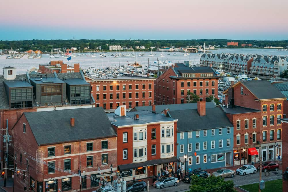 A sunset view of downtown and the harbor in Portland, Maine - how to spend a weekend in portland maine