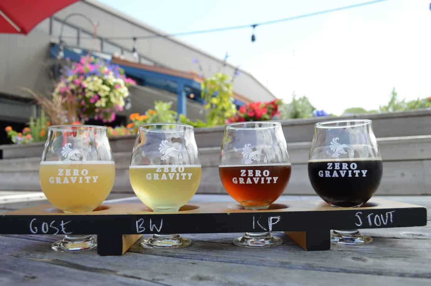 burlington VT breweries header image - flight of four beers ranging from light ale to a dark porter