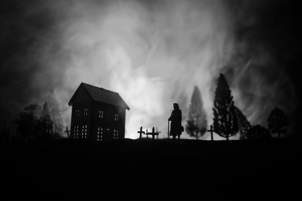 ghost tours in salem ma - Silhouette of old woman with a cane walking at cemetery at night. Horror Halloween concept. Artwork decoration with light and fog. Selective focus