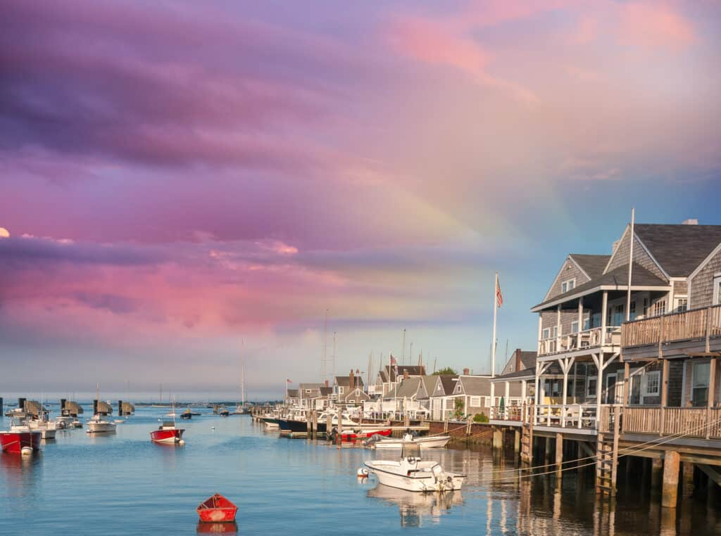 Beautiful homes of Nantucket, Massachusetts. Houses over water at dusk.