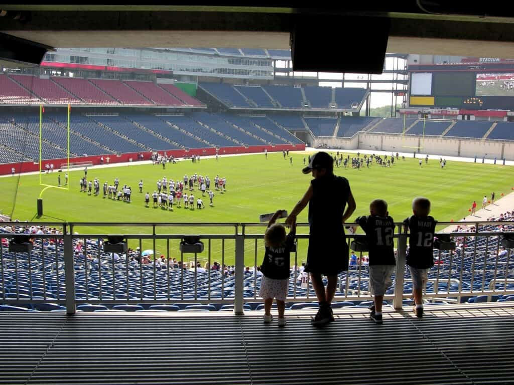 Young fans watch football practice in Foxboro, MA