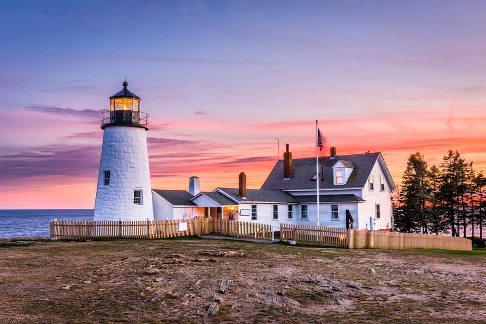 things to do in maine - image of iconic maine lighthouse and house on coast at sunset