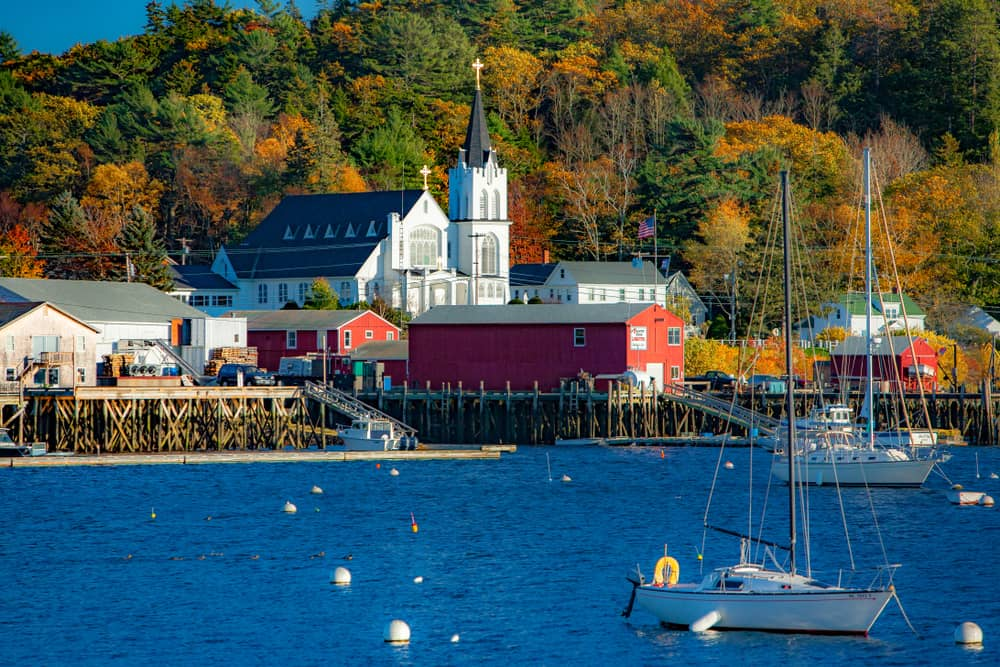 classic maine coastal town as seen from the water during autumn