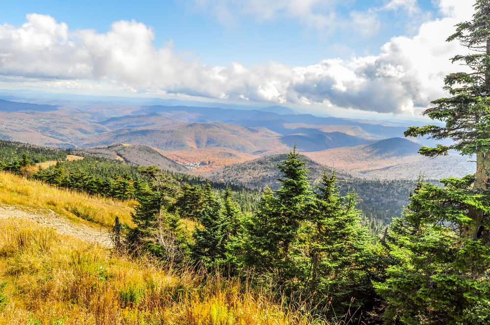 things to do in rutland vt header image mountains with early fall colors on sunny day