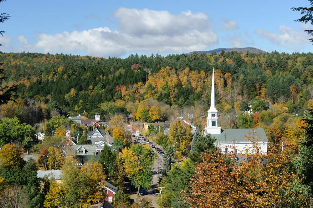 small towns in vermont - image of early fall day in small new england town with white steepled church and village