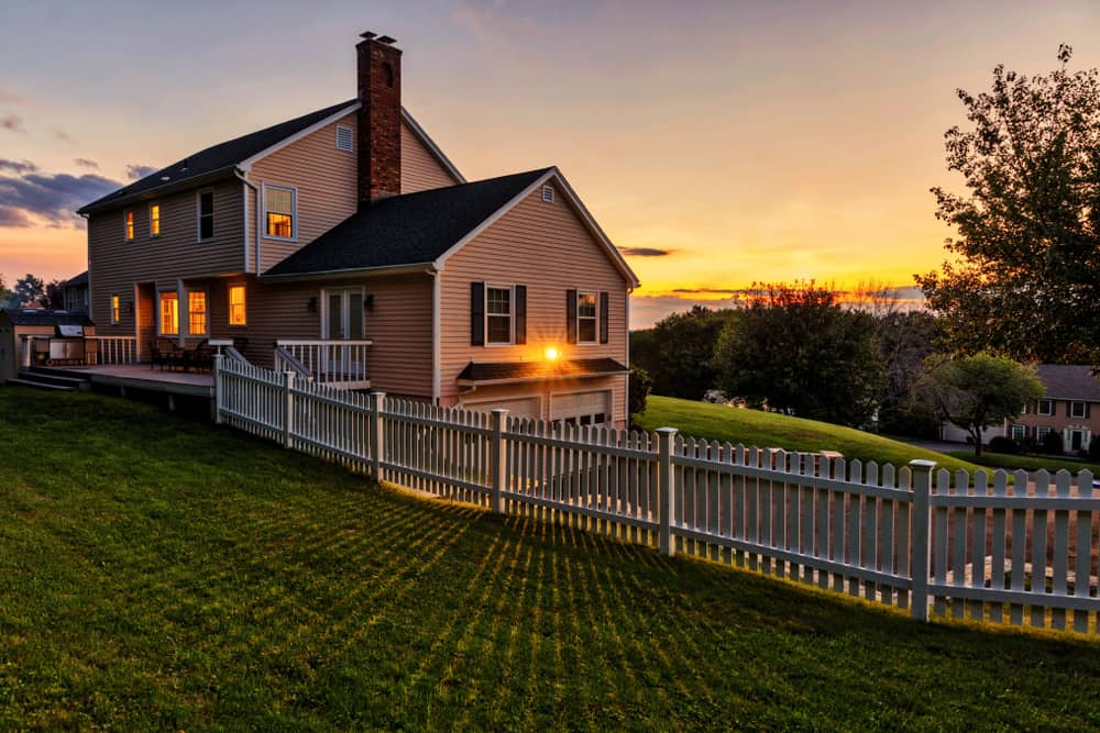 best airbnbs in the berkshires ma - image of classic house at sunset on a green rolling hill