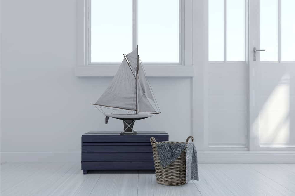 Nantucket Airbnb header - image of model sailboat in clean white room