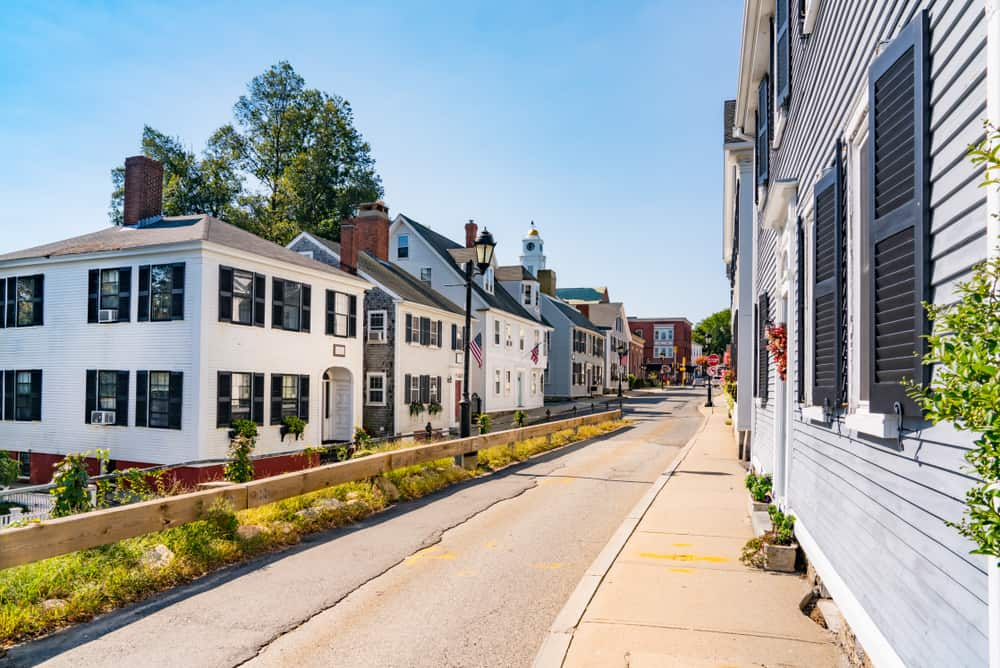 things to do in plymouth ma - photo of colonial homes along street in massachusetts, sunny day