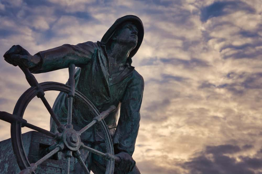 the fisherman's memorial statue of a man at the wheel of a ship, one of the best things to do in gloucester ma