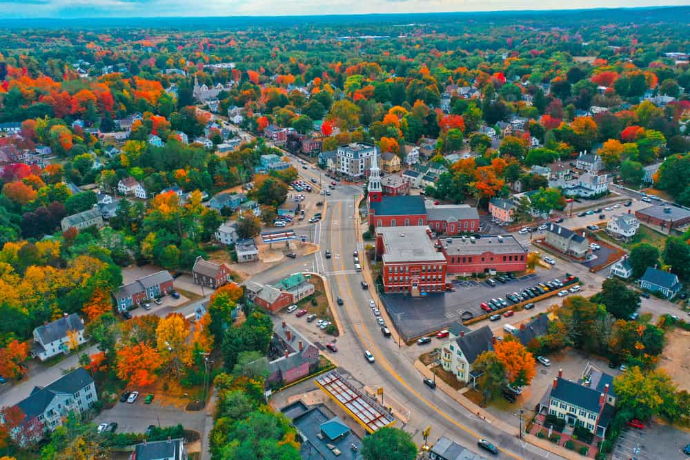 small towns in new hampshire - the town of Dover NH as seen from the air, small town with fall leaves