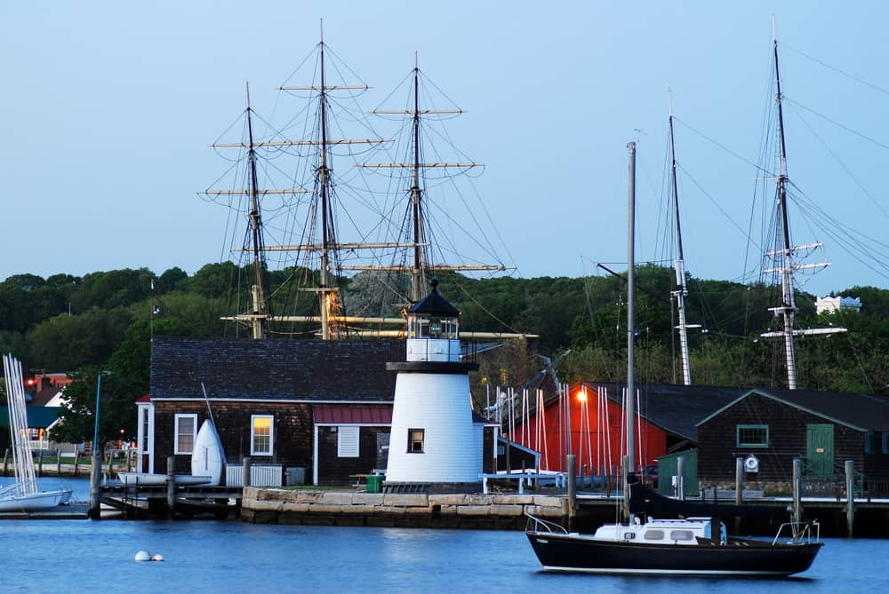 A quiet calm falls upon the Mystic Seaport in Connecticut, where tall masts of an historic wooden whaling ship towers over a small lighthouse