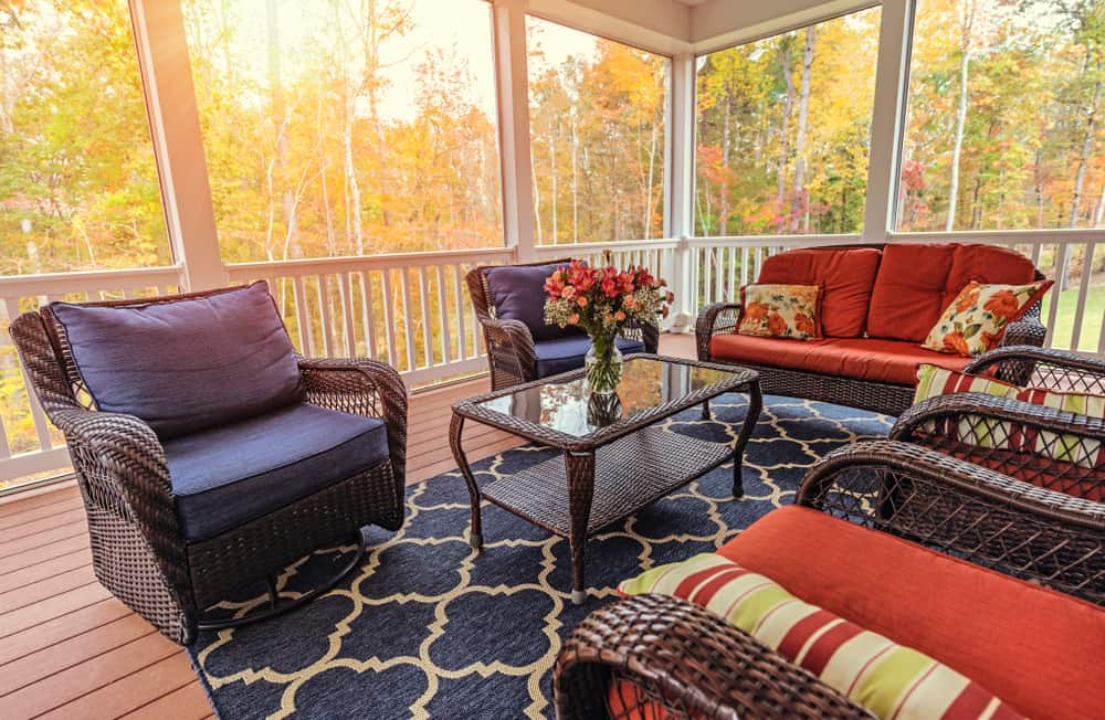 new england vacation rentals - red and black chairs decorate calm and beatiful porch with fall foliage outside