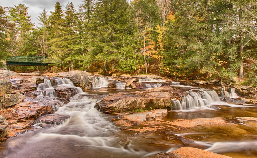 small tiered waterfall in new hampshire during early fall