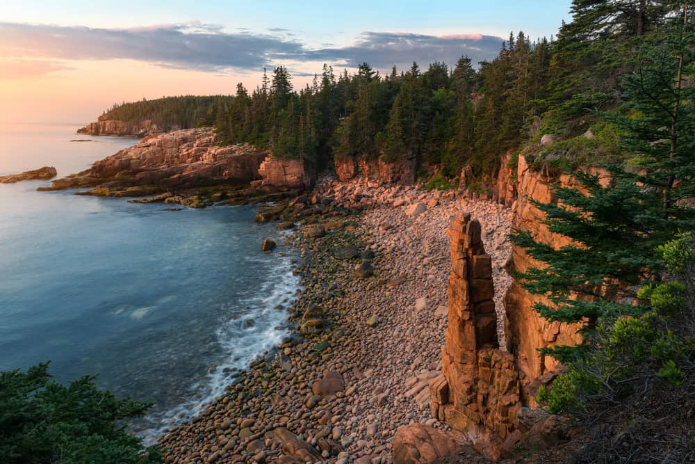 sunset over the rocky beaches in acadia national park maine