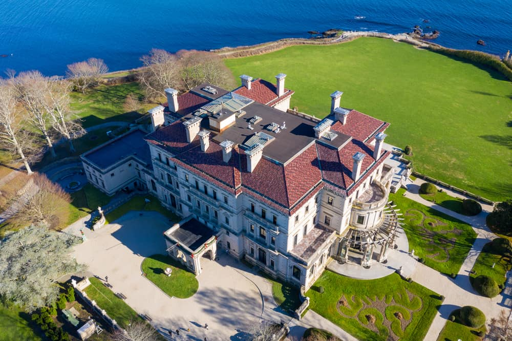 drone view of red and white mansion called the Breakers