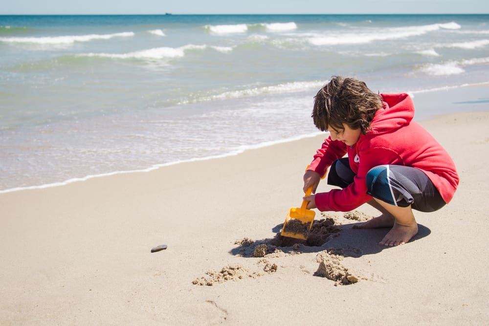 One of the Things to Do in Cape Cod With Kids is to let them play on the beach with sand