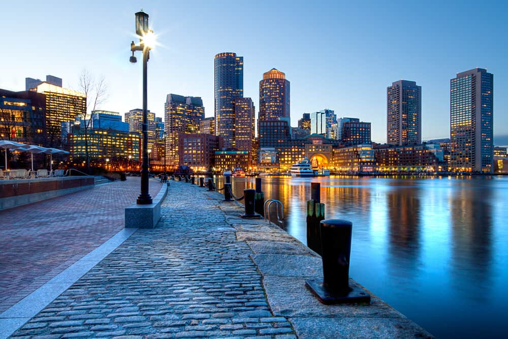 A streetlamp by the bay in Boston Harbor at night time