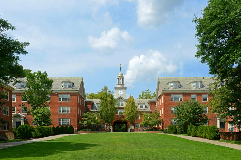 a classic university campus - Brown University's brick buildings behind a wide green lawn
