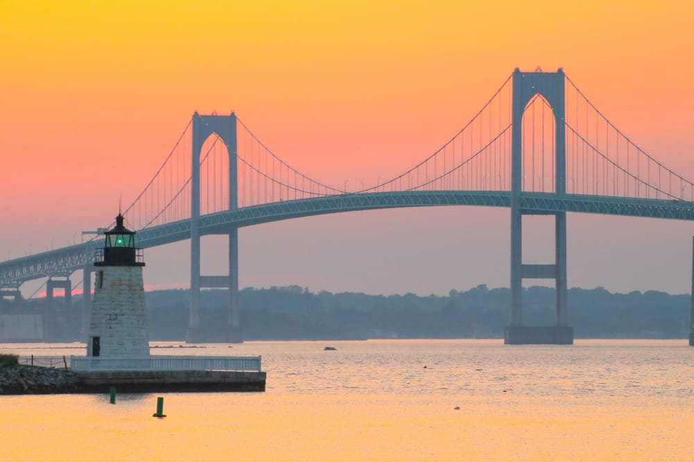 a bridge over the sea at sunset in newport one of the most beautiful places in Rhode island