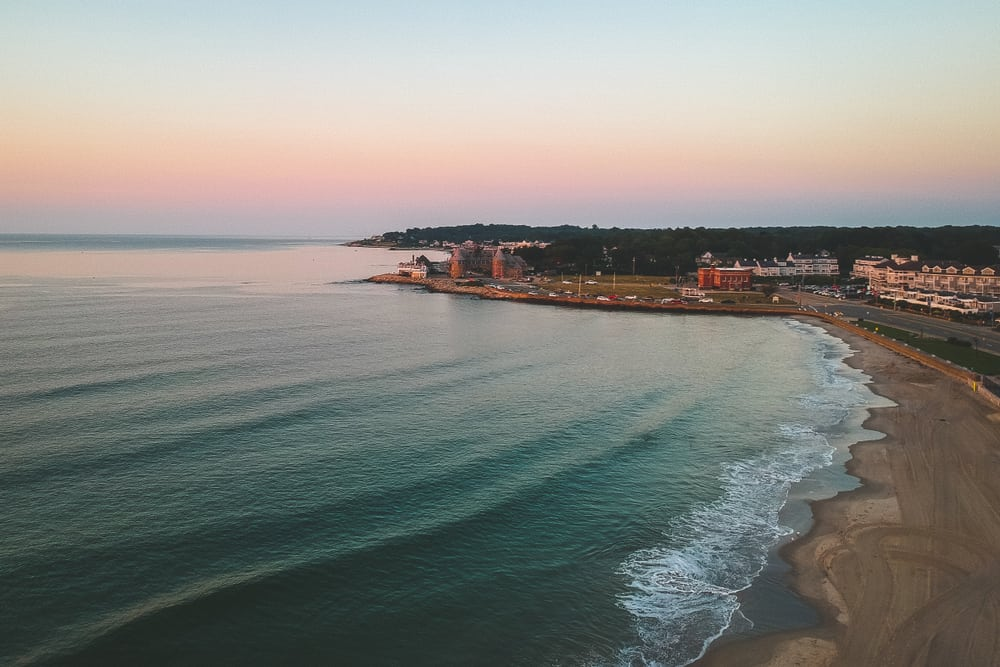drone view of the seashore in Narragansett Rhode Island, an empty beach fringed by gentle surf