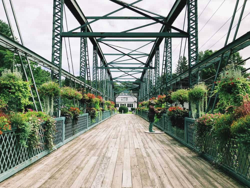 This is a picture of a stunning bridge decorated with plants called Old Drake Hill Bridge