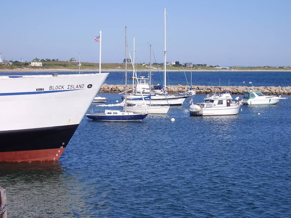 a new england harbor filled with sail boats
