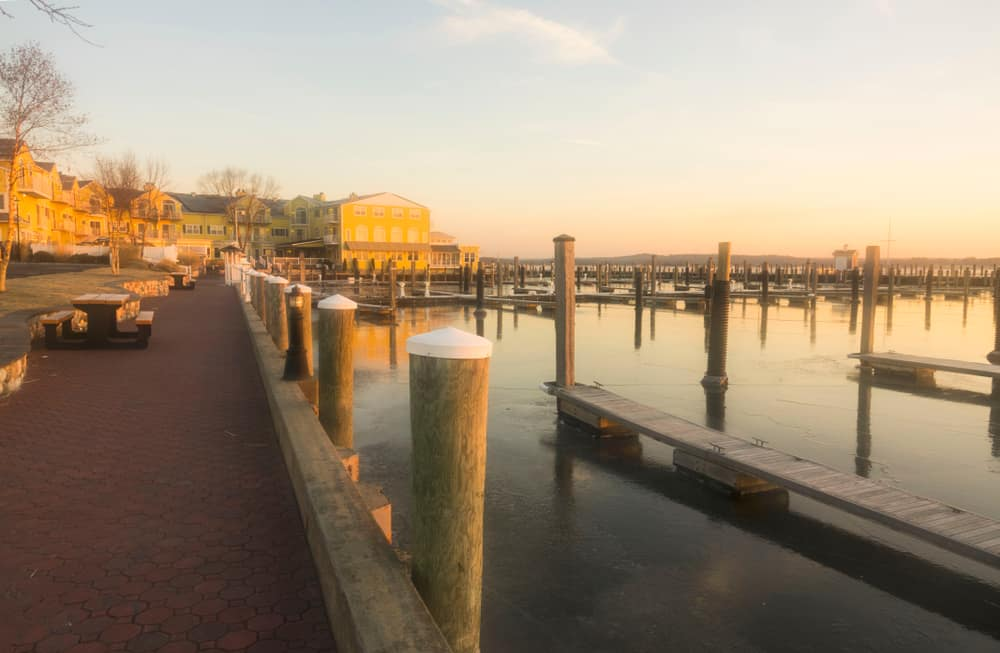 A picture of an early morning along a new england waterfront, docks are empty