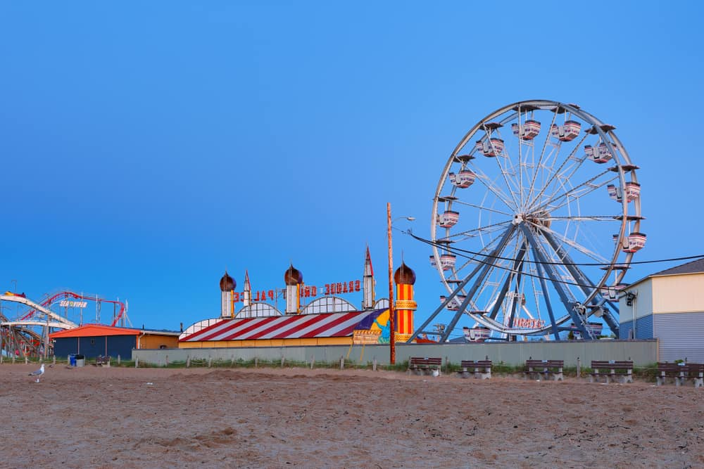 Ferris wheel and other rides on the sandy beach