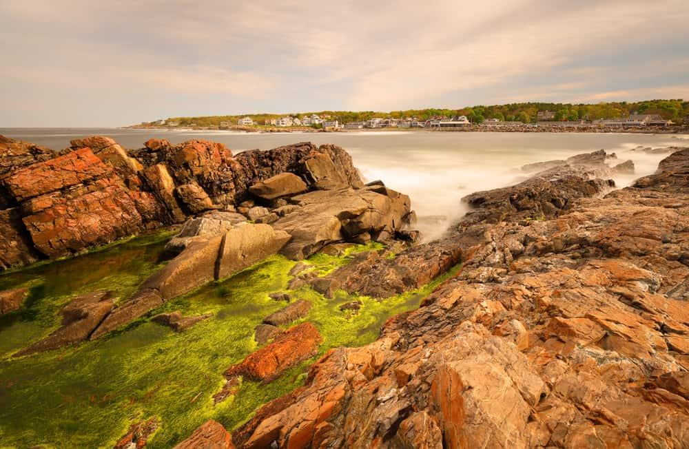 rocky coast of maine bathed in warm orange light