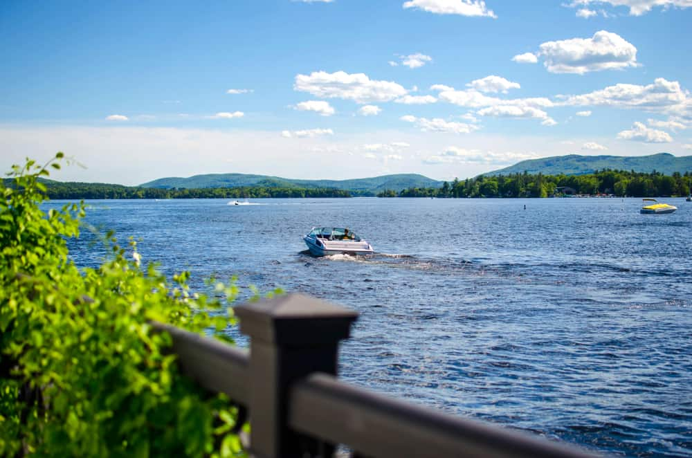Boat docks on a lake with mountain background. Wolfeboro New Hampshire