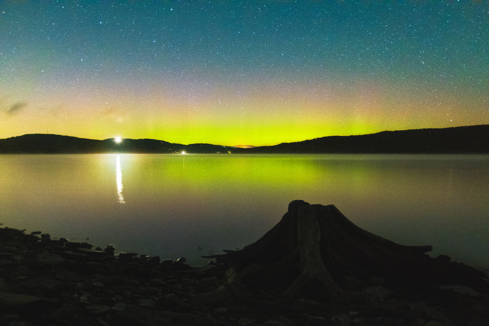 northern lights seen over a new hampshire lake at night