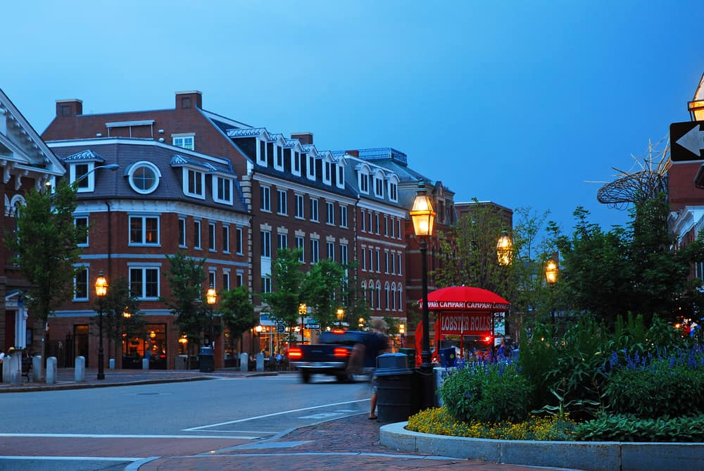 portsmouth new hampshire downtown at dusk- streetlampts in front of brick buildings on a summer evening