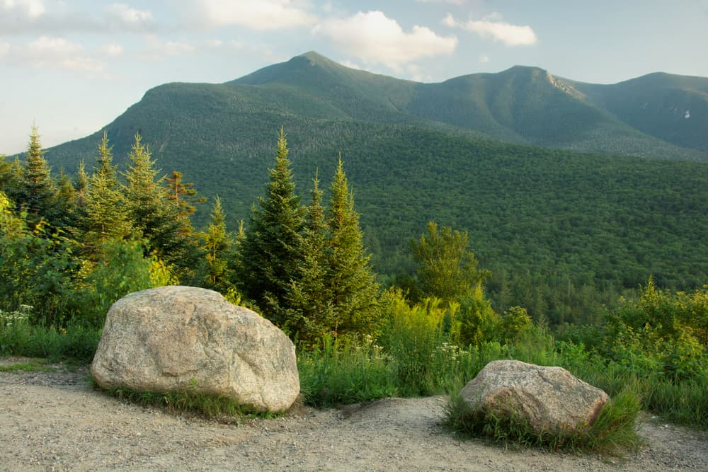 View from Kancamagus Highway, White Mountain National Forest, New Hampshire. Scenic vista of lush green foliage and tall peaks along the ridge of rugged Mount Osceola