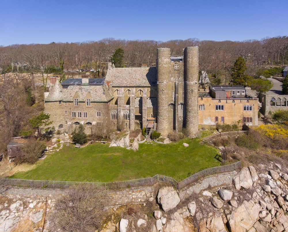a turn of the century castle sits atop a cliff, gloucester massachusetts