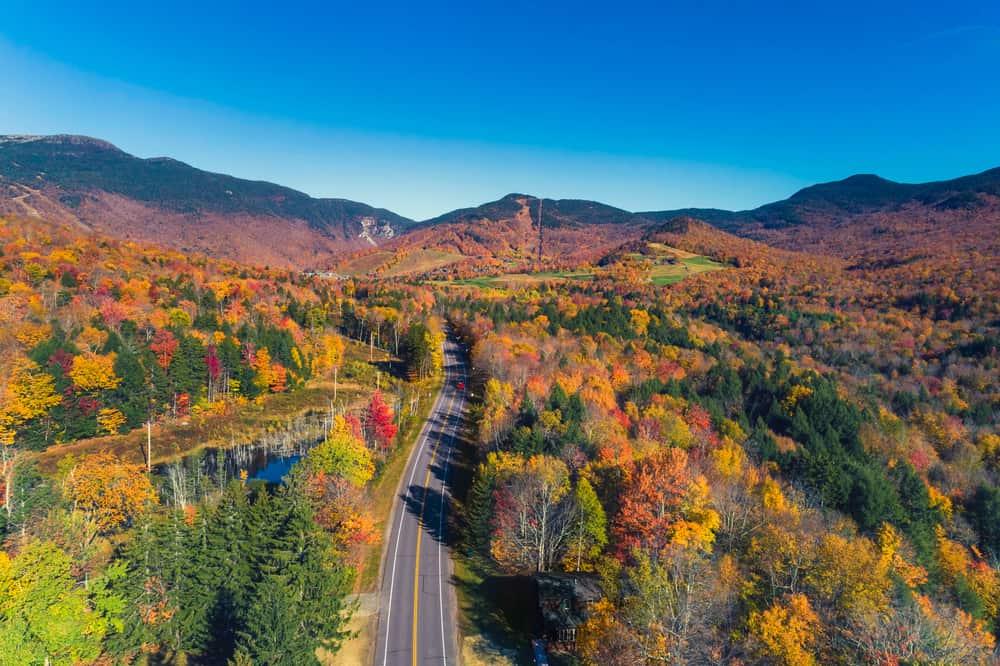 aerial shot of autumn road in vermont