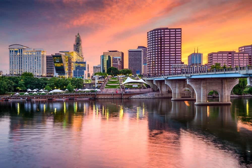 skyline of hartford connecticut seen at sunset next to the river