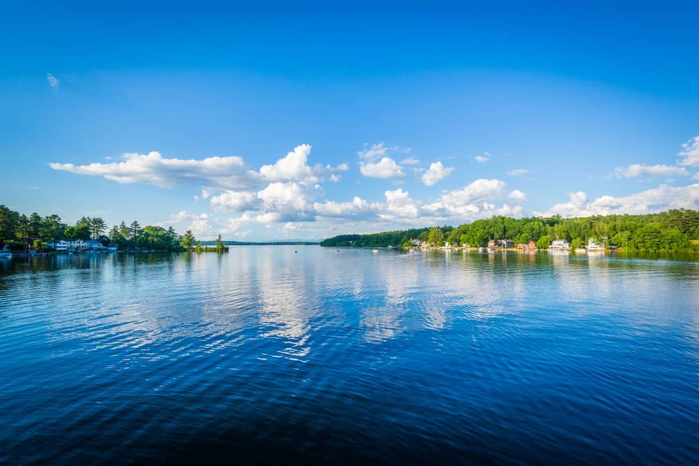 blue sky reflected in big lake on a clear summer day