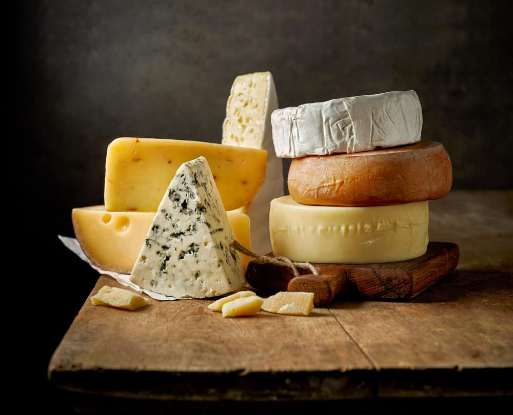 Plate filled with different kinds of cheese.
