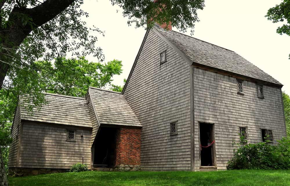 old grey house with door open