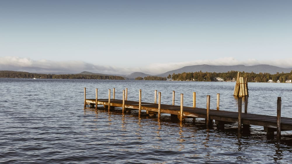 new hampshire lake winnipesaukee with a long dock in the foreground