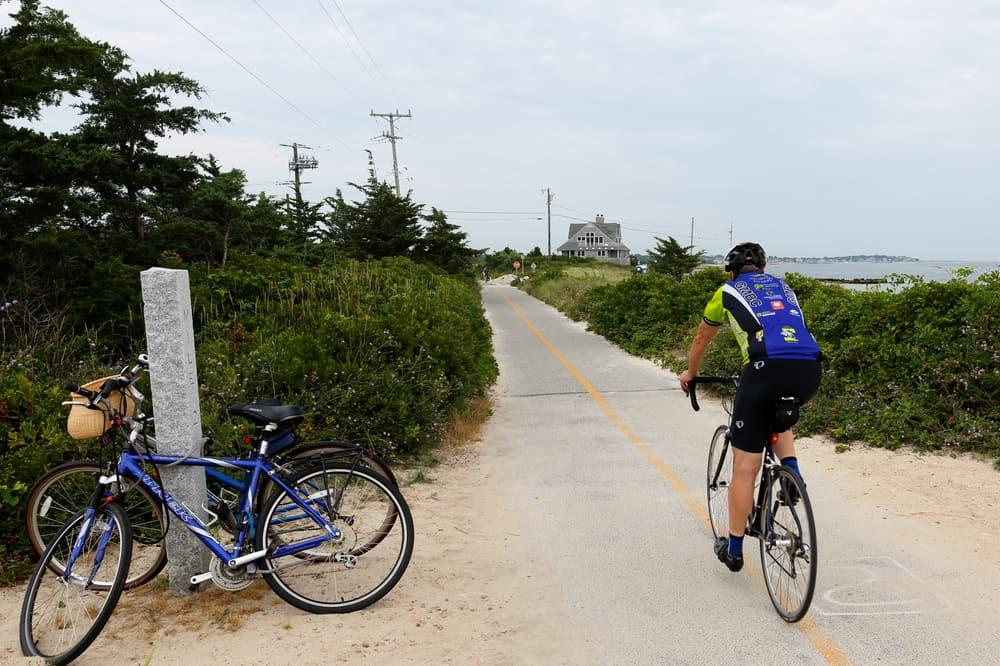 man biking on cement trail