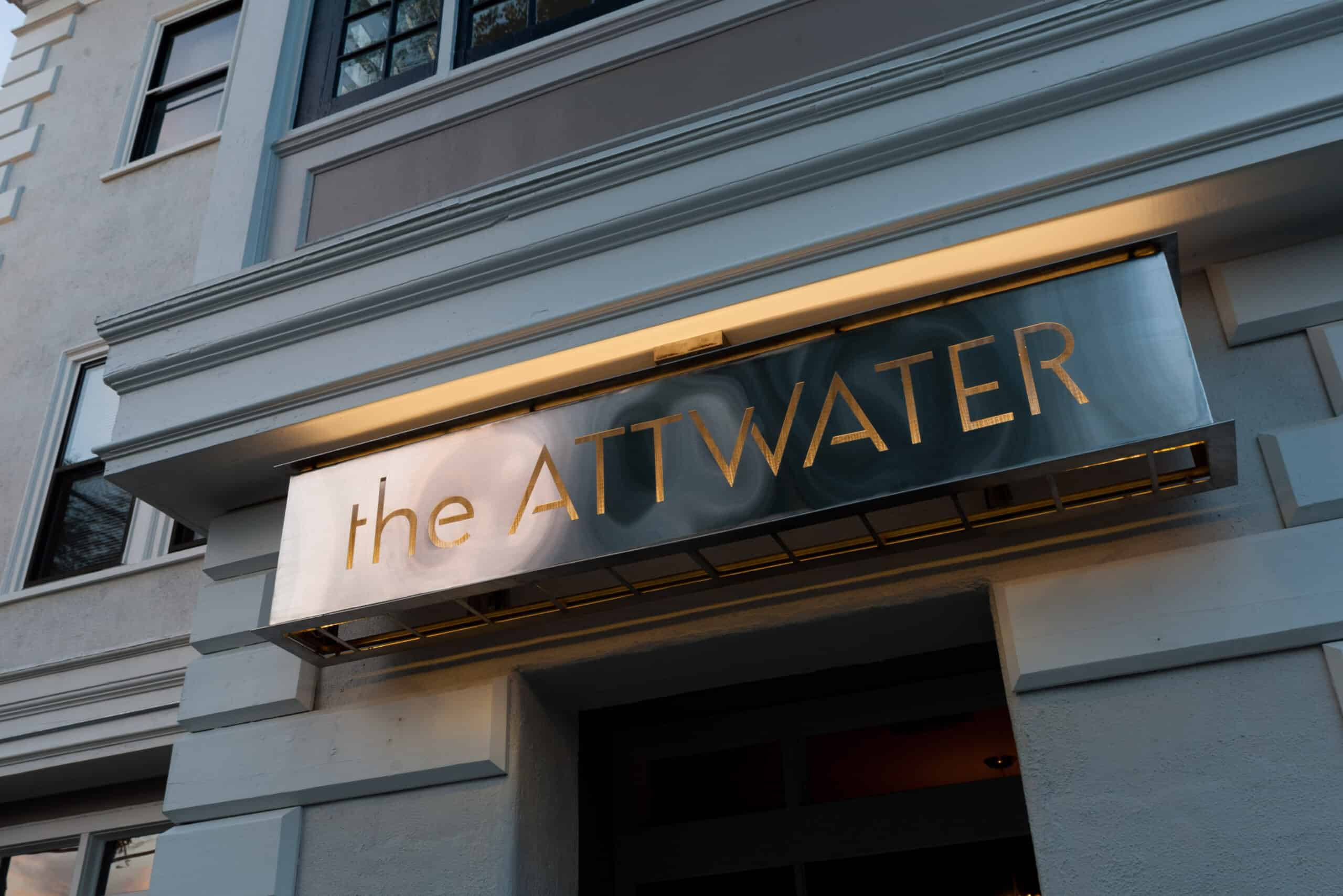 Close up of a luxury hotel that says The Attwater