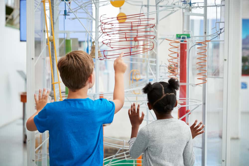 Two children looking at a science exhibit