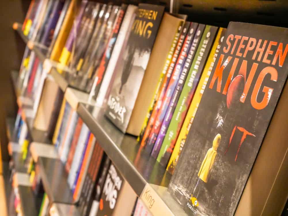 Row of Stephen King's books on a shelf.