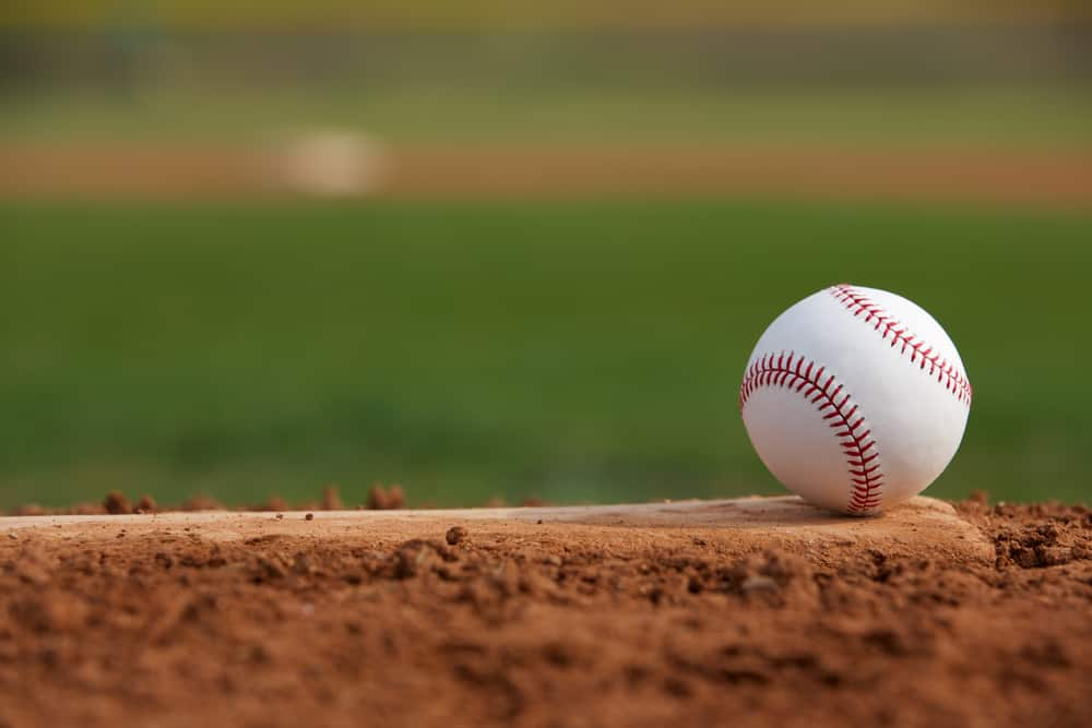 Baseball sitting on a field.