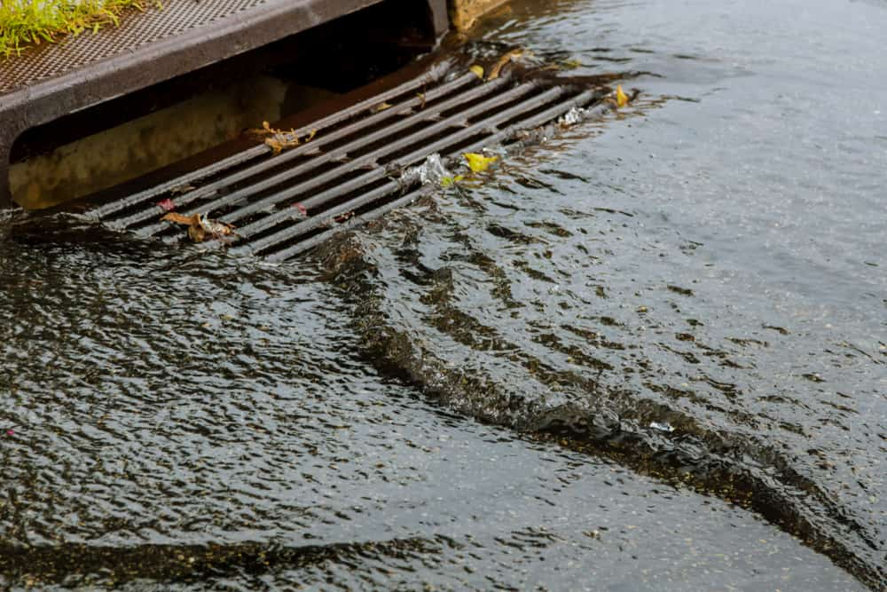 Sewer in concrete on a rainy day.
