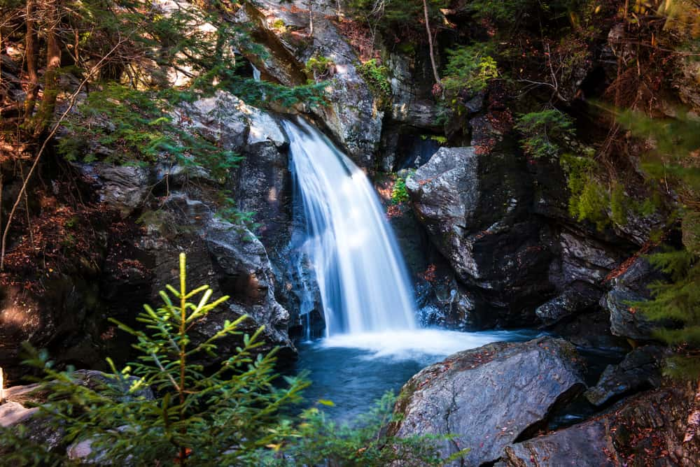 Blue waterfall with stones