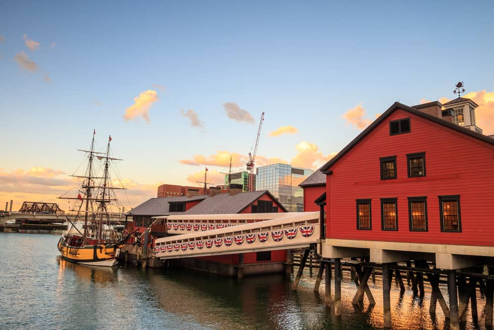 Red building and a boat on the waterfront