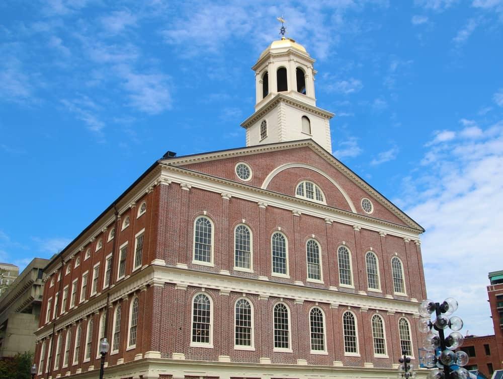 Historic brick building under a blue sky